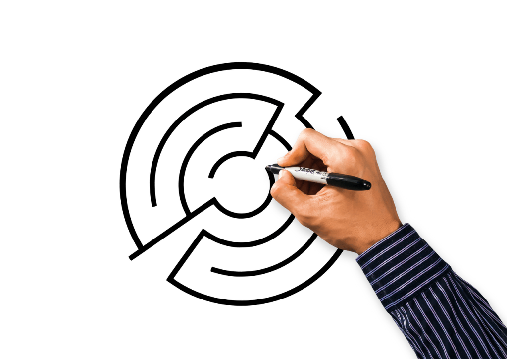 person drawing a maze